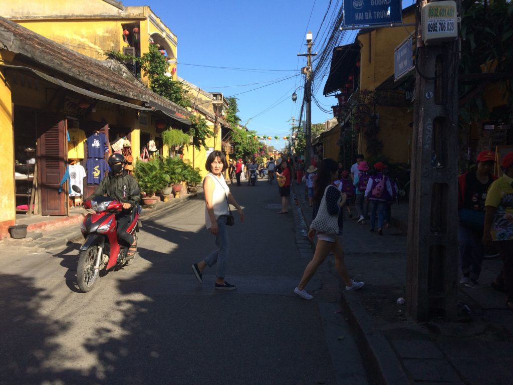 Busy street with tourists in Hoian